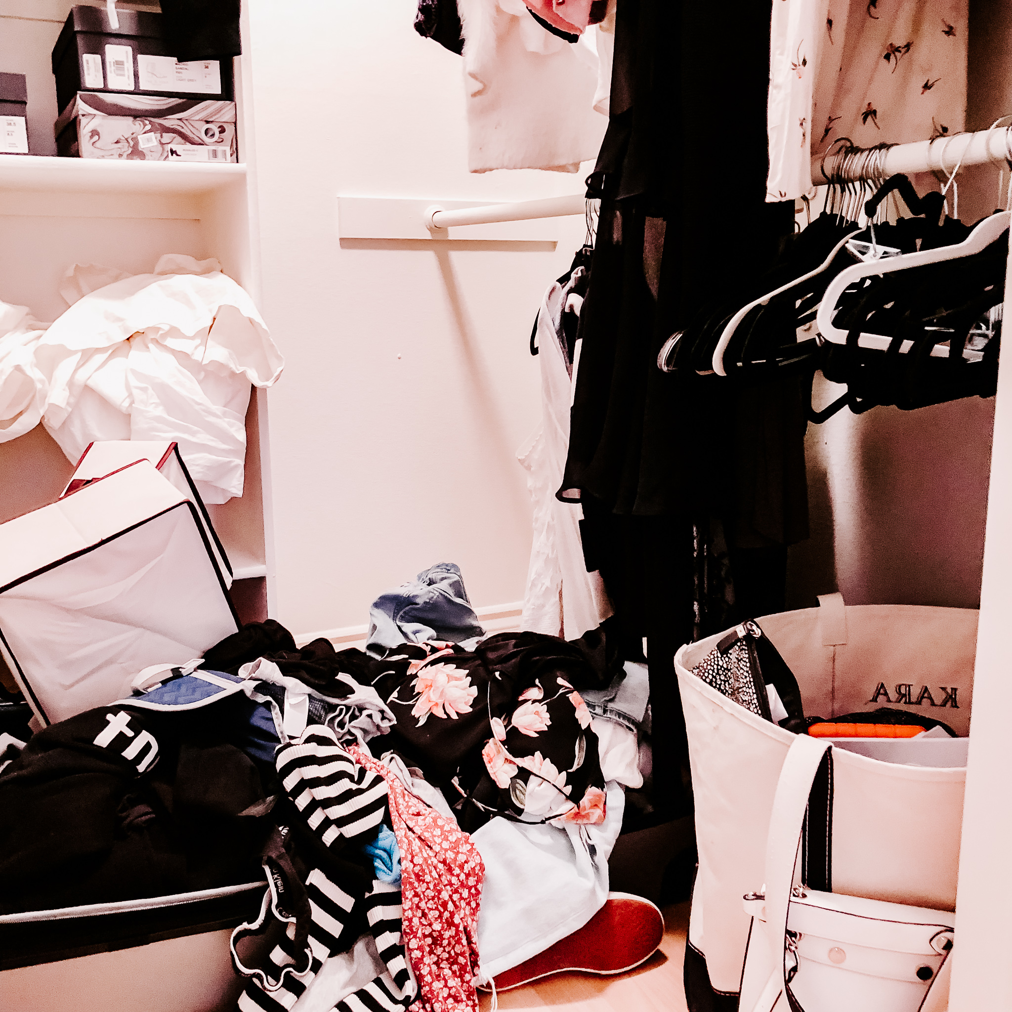 a messy closet in need of decluttering and organization