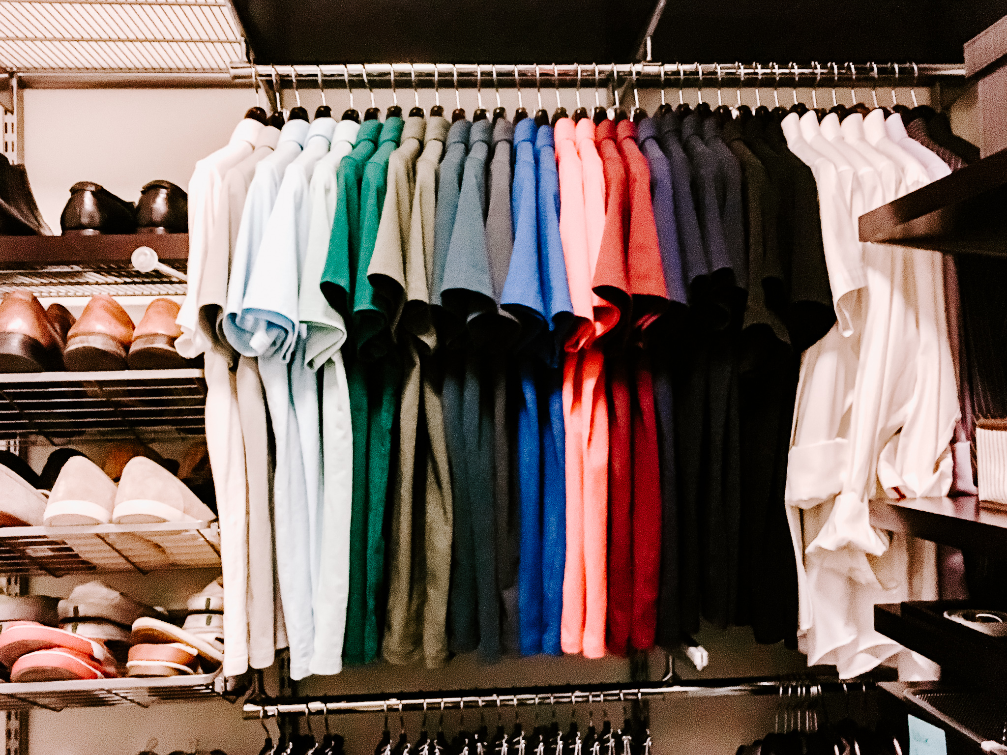 a color coded clothing closet organized to perfection